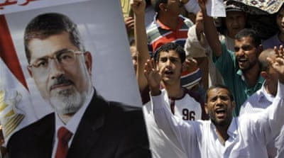 Defiant Morsi supporters march in Cairo