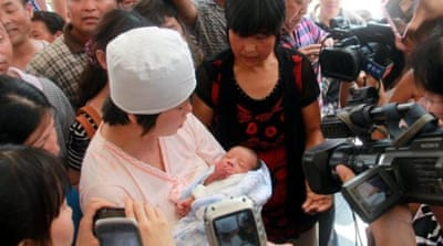 Chinese doctor held over baby trafficking