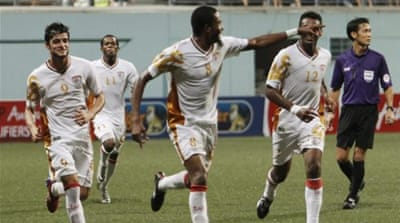 Oman midfielder Eid Al-Farsi (2ndR) dances with teammates after scoring second against Singapore [AFP]