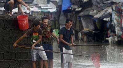 Rain pounds Manila as flood death toll climbs
