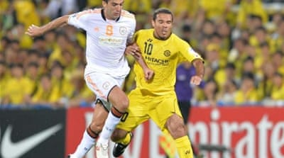 Al Shabab midfielder Menegazzo (R) connected with a corner to equalise against Kashiwa in first leg [AFP]