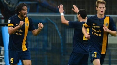 Toni celebrated Verona's return to the top flight with two goals as his team beat Italian giants Milan [AP]
