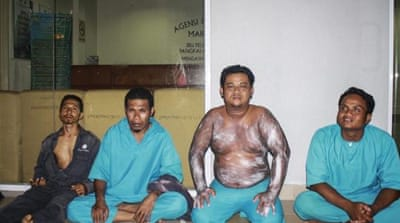 After being sent to hospital for treatment, the rescued Indonesians are in custody [EPA]