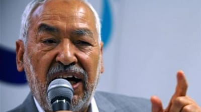 Ghannouchi says his party is 'open to bringing opposition forces into coalition government' [AP]