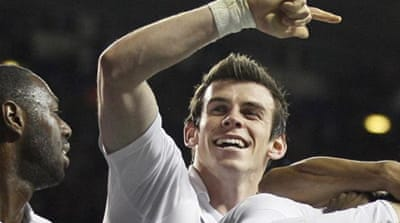Real target: The sale of Bale is still capturing headlines as Spurs fight for best deal possible [AP]