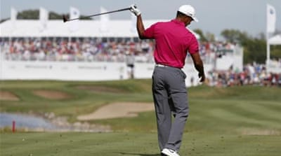 Woods has struggled with his final round this season but is still on track of landing a $10million prize [AP]