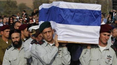 Sharon buried in Israel state ceremony