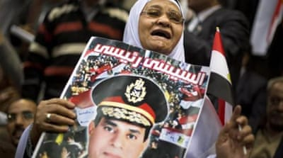 A campaign titled 'complete your good deeds' urges Sisi to run for president  [AP]