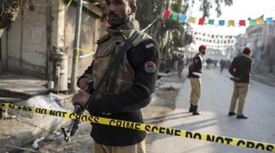 A suicide bomber killed 10 people in a market near the army headquarters in Rawalpindi [Reuters]