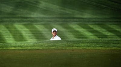 McIlroy dug himself out of a few holes on day two to retain the lead at the Emirates Golf Club [AFP]