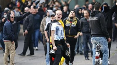 Football hooligans and neo-Nazi groups organised an October 26 demonstration against Islamic extremism [Reuters]