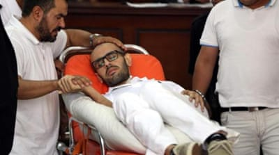 Mohammed Soltan in court hall before the trial that accuses him with 'misinforming the media' [AFP]