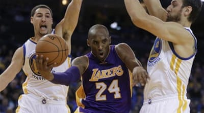Bryant (24) scored 44 points but Lakers still went down by 21 points [AP]