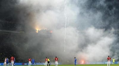 Croatia's supporters throw flares onto the field [REUTERS]