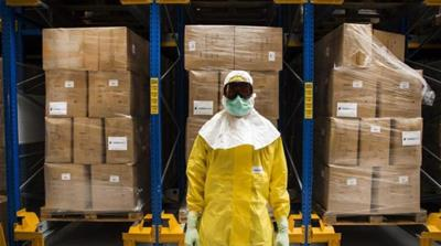 An employee of a factory tries on special Ebola gear in Berkel en Rodenrijs, The Netherlands [EPA]