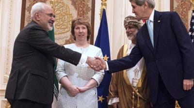 Kerry (R) and Zarif (L) had two meetings lasting more than five hours in Muscat [EPA]