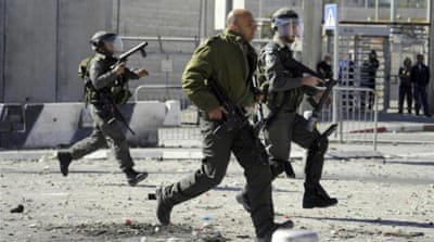 Israeli border police run during clashes with Palestinians [AP]
