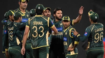 Afridi (3R) was leading the side in the absence of Misbah [AFP]