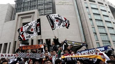 Turkish soccer club Besiktas' fan group 'Carsi' members gather in front of a courthouse to protest against the trial of 35 'Carsi' fans who took part in mass anti-government protests in 2013 [EPA]