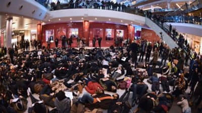 Protesters create a 'die-in' at the Westfield shopping mall in West London [AFP]