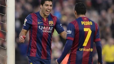 Suarez (L) signed for Barcelona this summer [AFP]