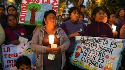 Candlelight vigil a day before the inauguration of Climate Change Conference in Lima [AP]
