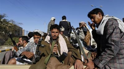 Shia Houthi rebels ride on a patrol truck in Sanaa [Reuters]