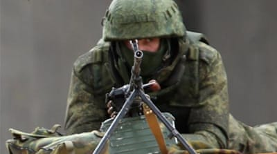 Ukrainian soldiers withdrawing from Simferopol in Crimea [AP]