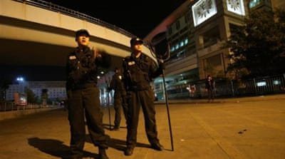 China captures train station attack suspects