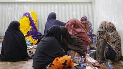 Women and children are among the thousands of Somalis detained in Kenya [AP]