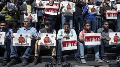 Journalists and photojournalists demonstrate in Cairo against repeated attacks on members of the press in Egypt [AFP]
