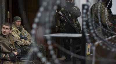 Pro-Russian gunmen have taken over several key state buildings in eastern Ukraine [AP]