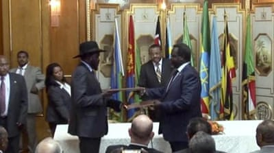 South Sudan's President Salva Kiir and rebel leader Riek Machar prior to signing a cease-fire deal in Addis Ababa [AP]