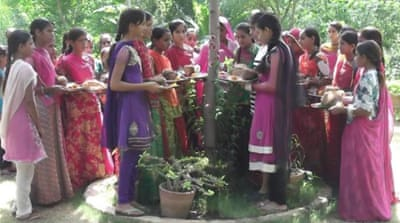 Celebrating the birth of girls by planting trees began by visionary village heads [Shahnawaz Akhtar/Al Jazeera]