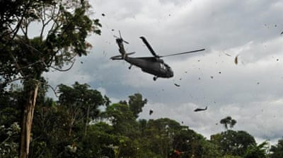 The US provided $310m in military and economic aid to Colombia in 2013 - much less than in previous years [AFP]
