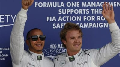 Hamilton (left) has won four of the five races this season [AP]