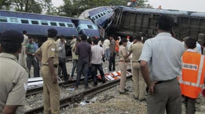 The collision on Monday caused six cars of the Gorakhdham Express passenger train to derail [AP]
