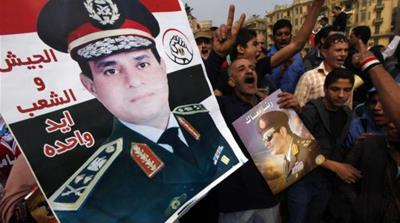 Abdel Fattah el-Sisi's victory in the presidential elections will endanger the balance of power between the civilian state and the army, writes Elmenshawy [Reuters]