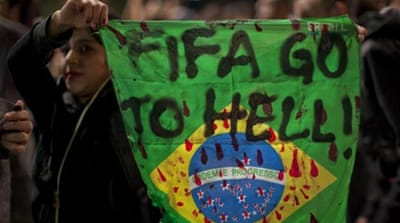 Demonstrators protest against the FIFA soccer World Cup Brazil 2014, in Sao Paulo, Brazil [EPA]