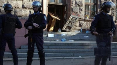 Policemen stand guard outside the burned trade union building in the southern Ukrainian city of Odessa [AFP]