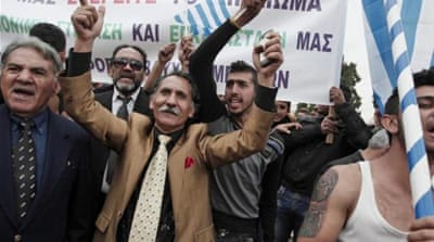 Ethnic Roma Greek protesters shout slogans during a demonstration in front of the Greek Parliament in Athens [EPA]