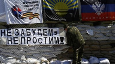 Ukraine's interim government and its allies blame Russia for fomenting the crisis in the country's east [AP]