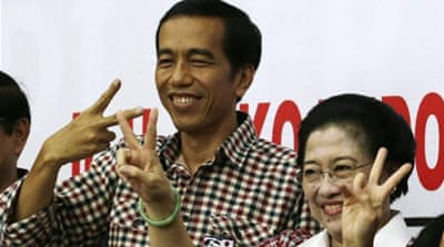 Joko Widodo's trademark style includes red and blue checkered shirts and cheap shoes [EPA]