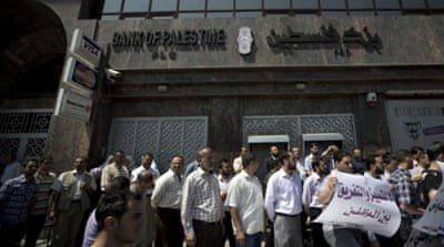 Hamas-appointed employees protested  what they describe as discriminatory measures by the new government against  them.[AFP]