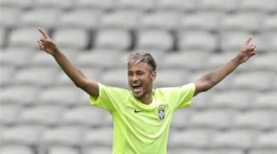 Neymar, with a new hair cut, will once again be leading Brazil's attack [AP]