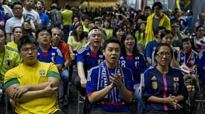 Japanese Brazilians say they plan on rooting for both Brazil and Japan during this year's World Cup [AP]