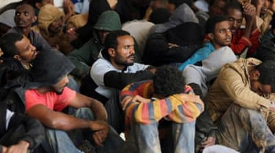 The migrants were hidden in boxes inside a vehicle to be smuggled out of Tripoli  [AFP]