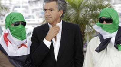 Levy is credited with persuading Sarkozy to spearhead NATO's war against Libya's Muammar Gaddafi in 2011 [AP]