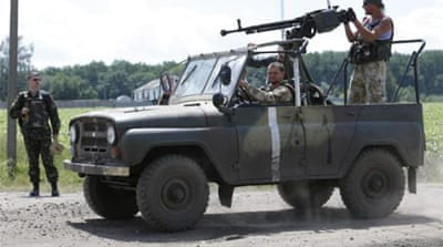 Ukraine lost nine servicemen when pro-Russian rebels shot down an army helicopter on Tuesday [AP]