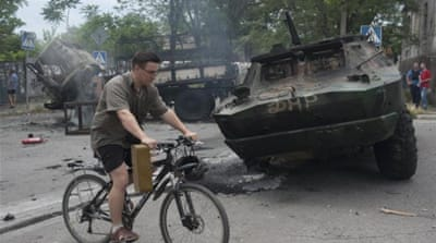 Mariupol residents continue with their lives amid simmering tension and fear [AP]